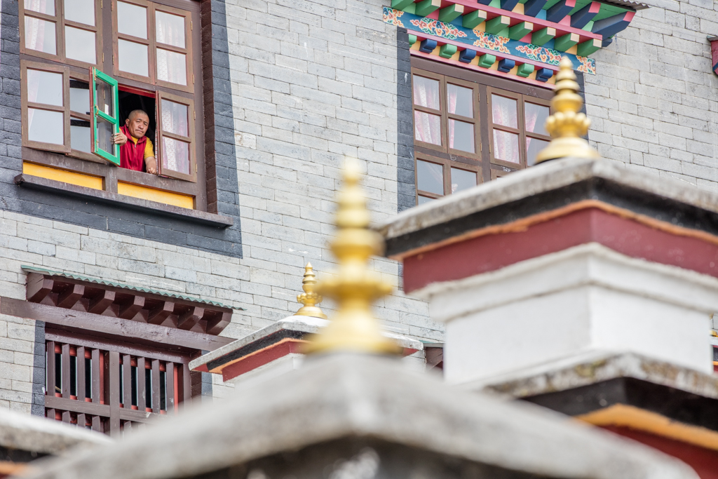 Monk viewing out of window