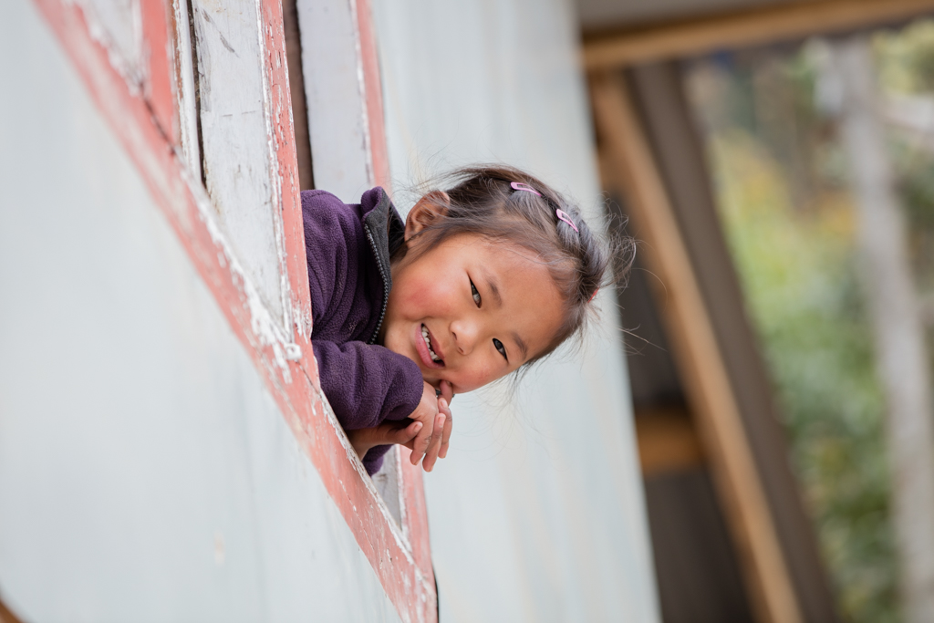 Little girl out of window