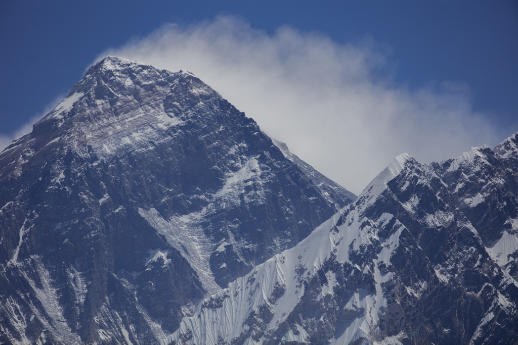 Mount Everest with high winds and clouds