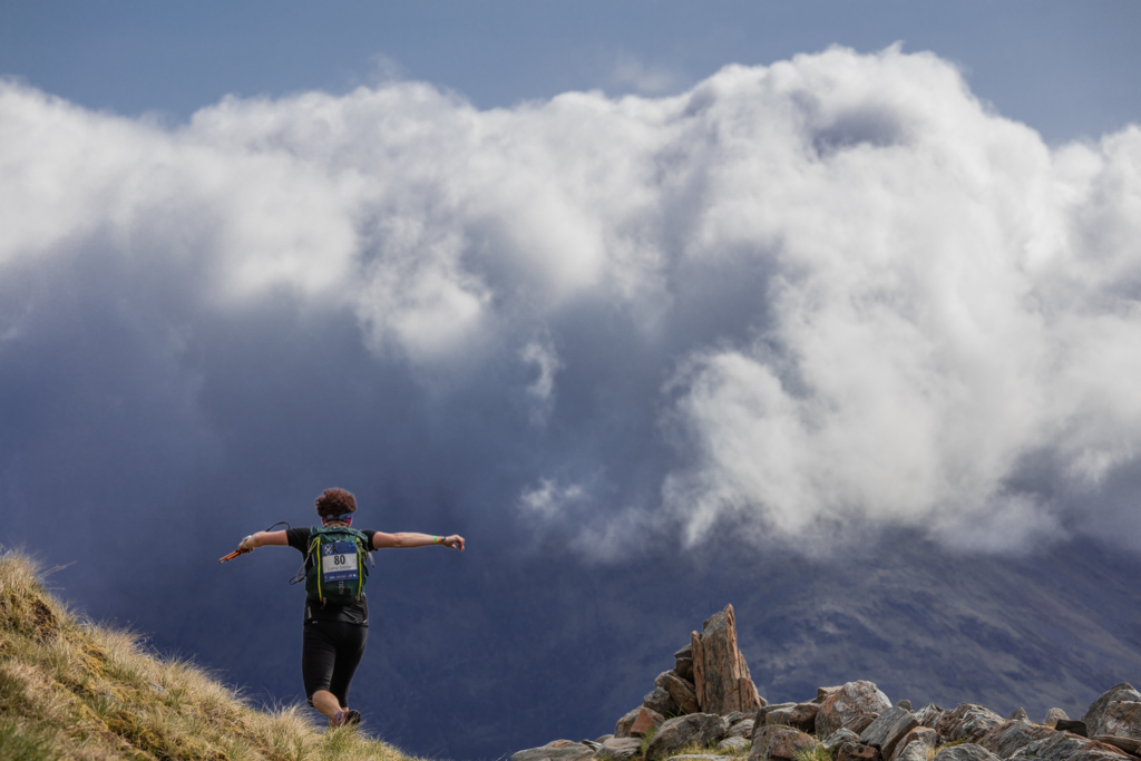 Runner with dramatic clouds
