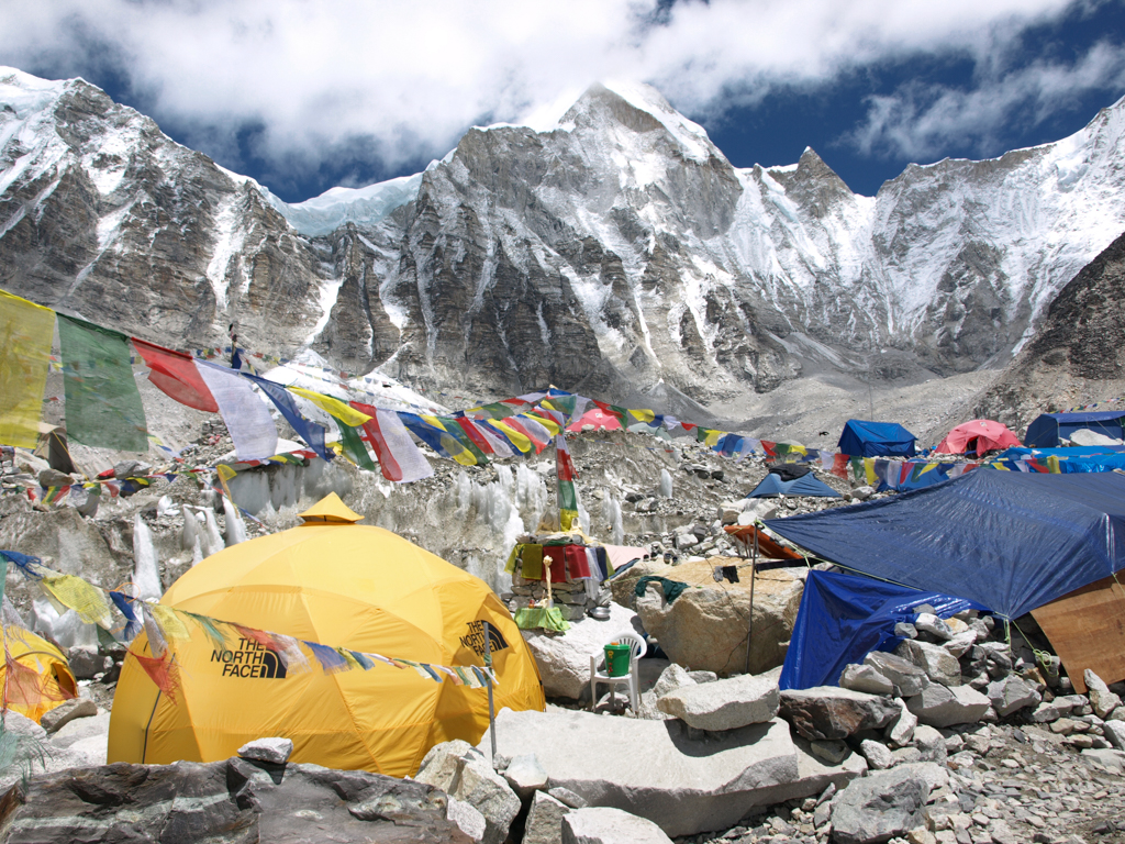 Colorful tents and clouds at Everest Base Camp