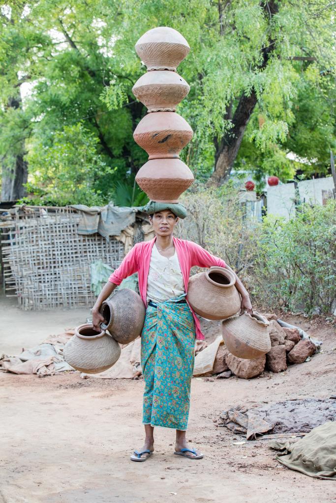 Balancing four mugs