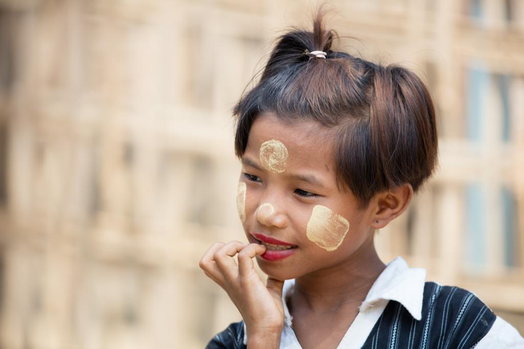 Young girl with Thanaka creme