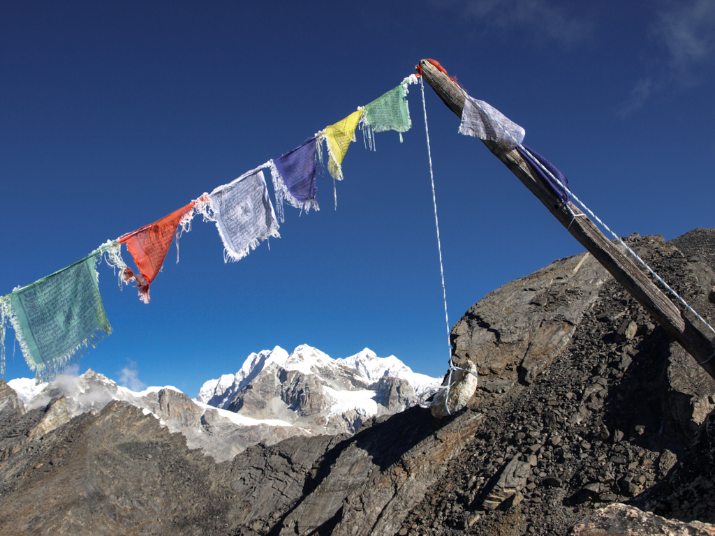 Prayer flags with stone
