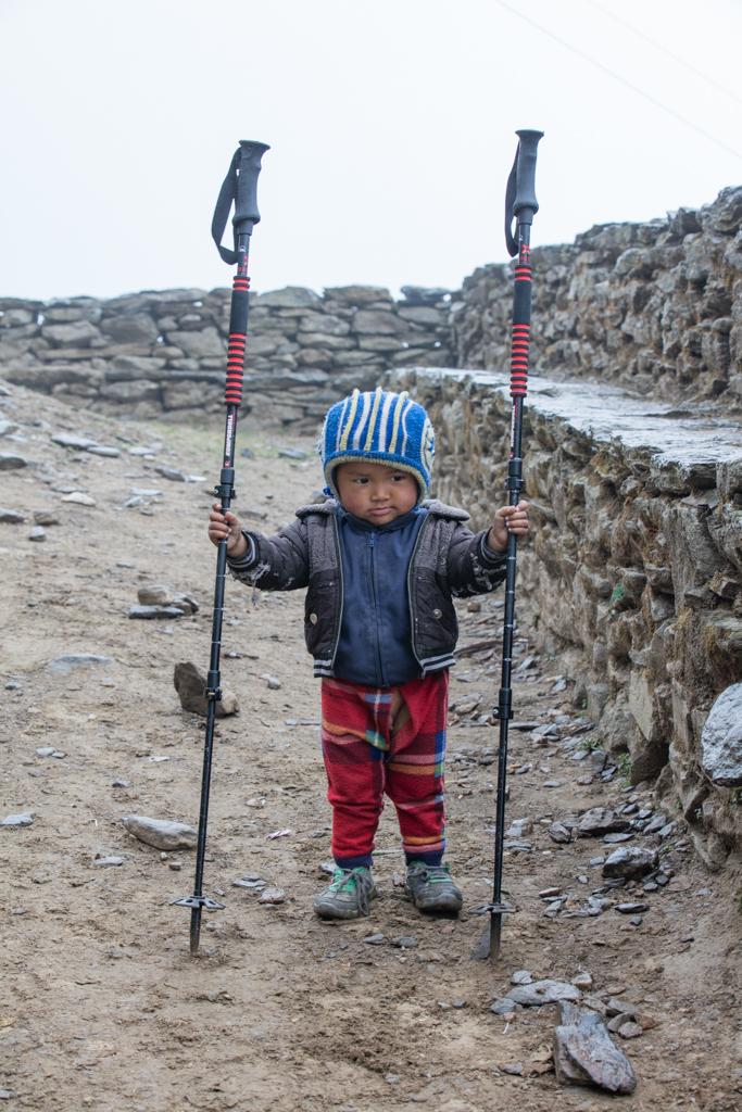 Nepalese boy with walking sticks