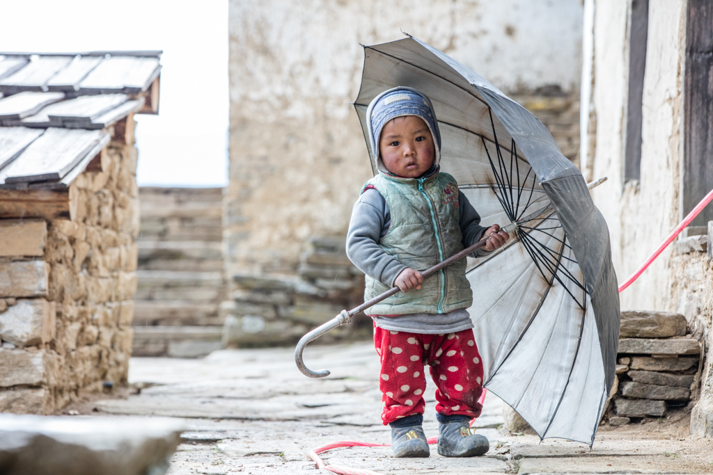 Nepalese child with umbrella