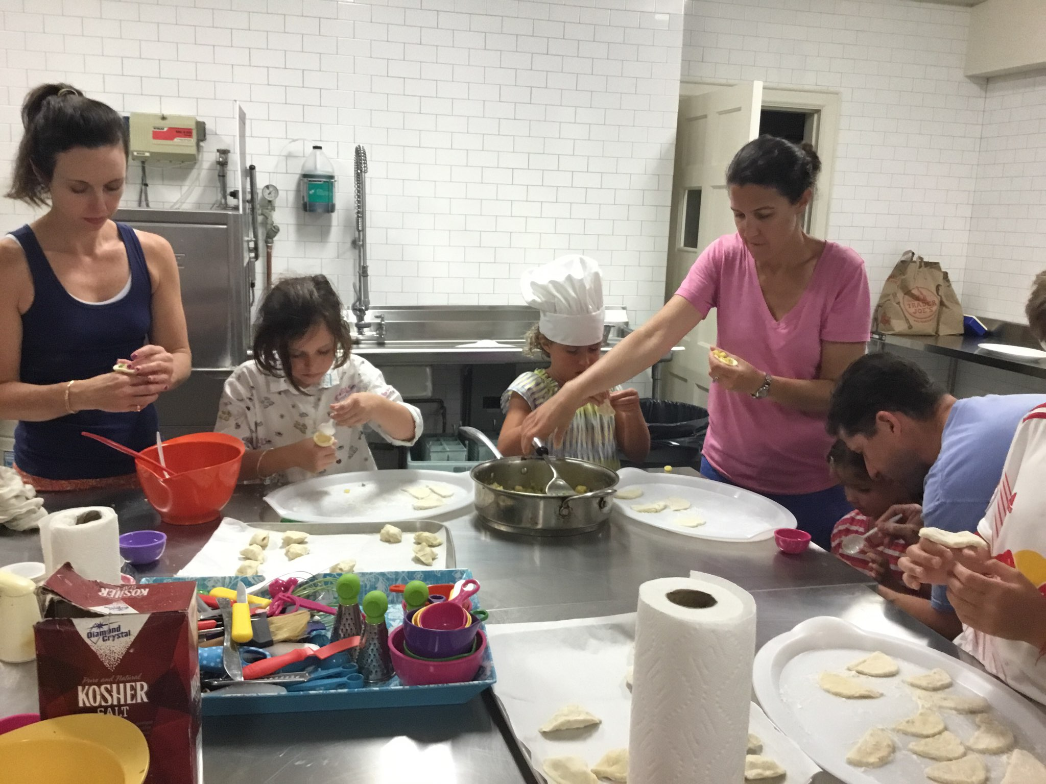 Families cooking together in one of our workshops and having a great time.
