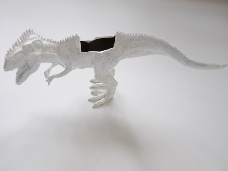 White painted dinosaur planter