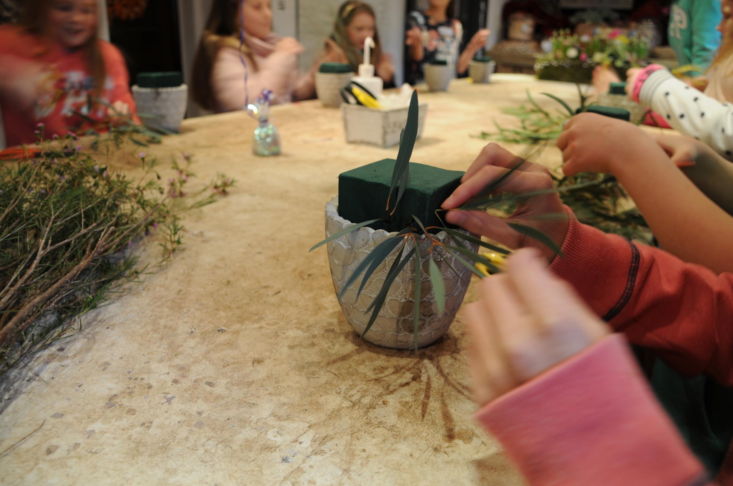 Adding foliage to the pots