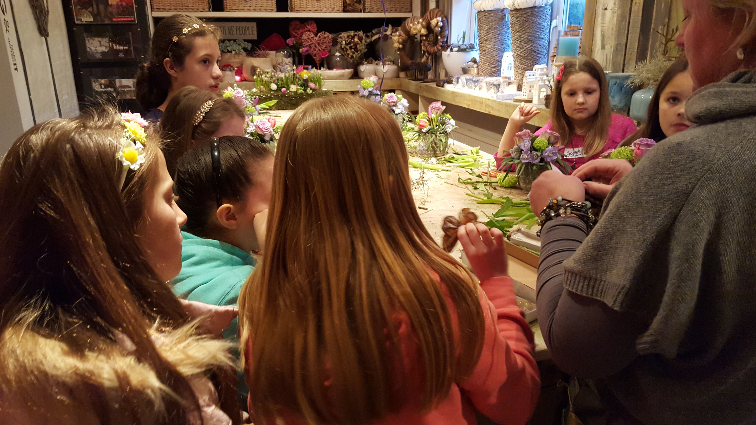 Adding pretty butterflies to the design. All in One Season Dutch floral party workshop