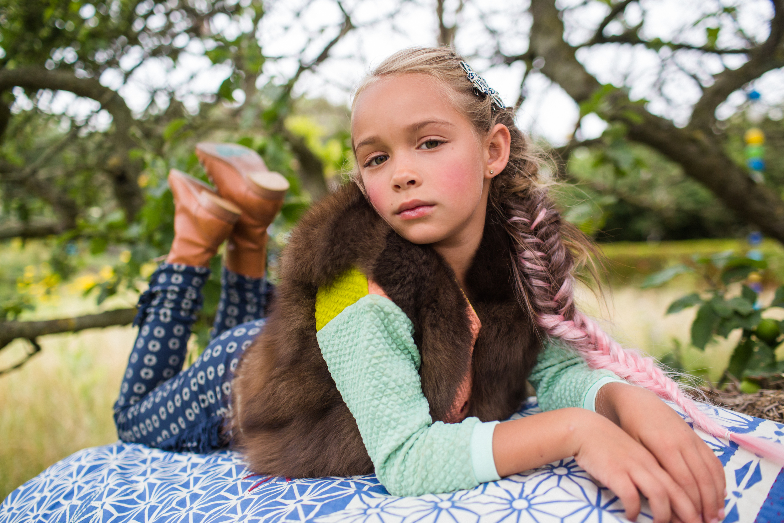 Little Flea Forever Nomad shoot. Warm alpaca, cost knits, shearling and feather prints for kids