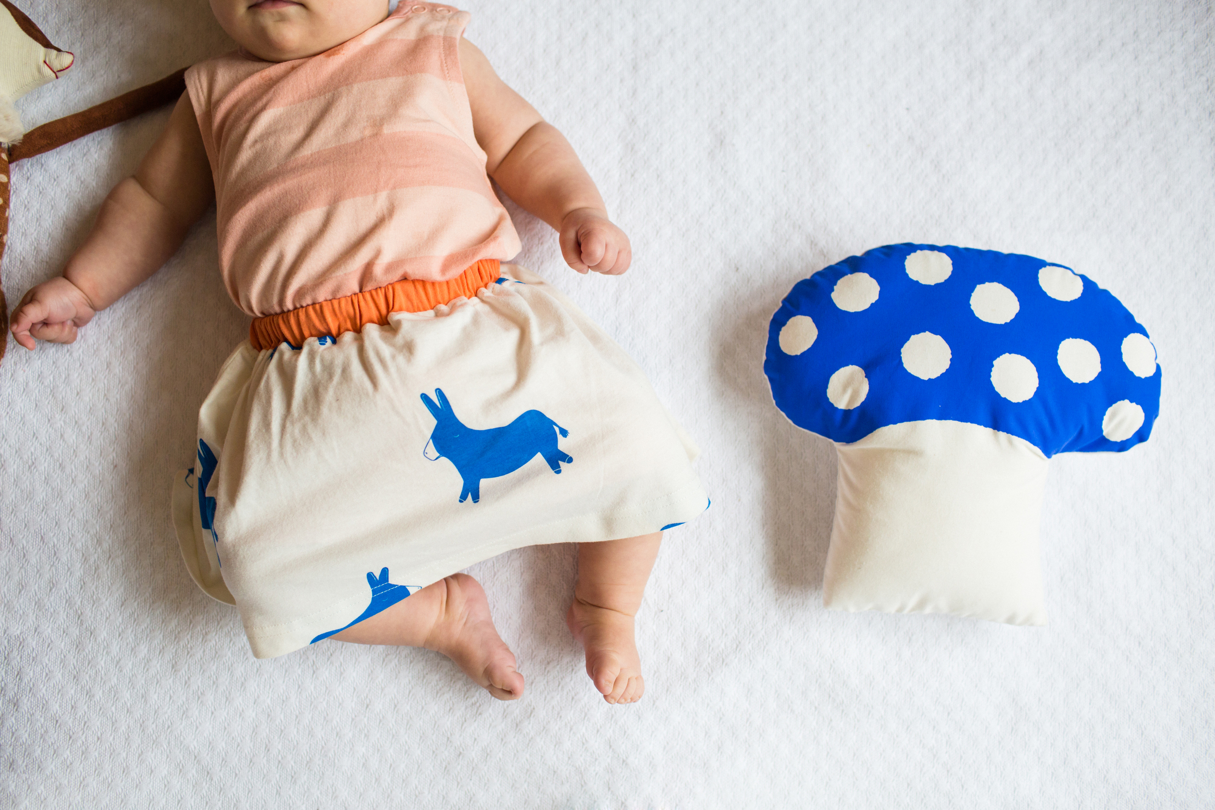 Donkey skirt , £18.20.  Toadstool cushion from  Le Train Fantome