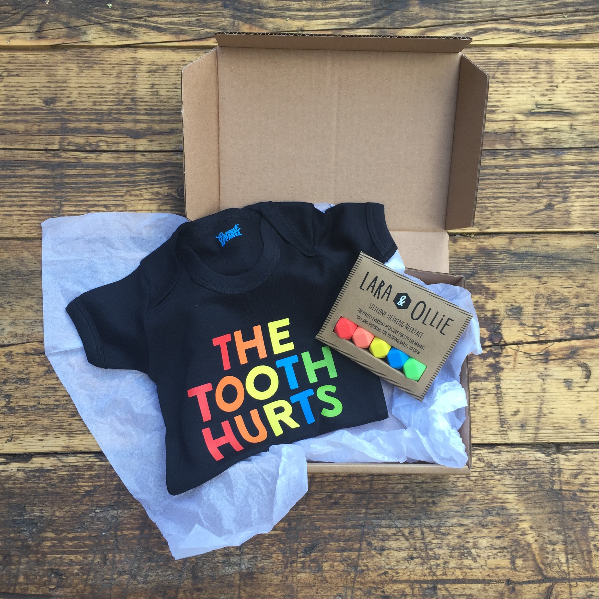 Lara and Ollie silicone teething necklace in collaboration with Parent Apparel gift box
