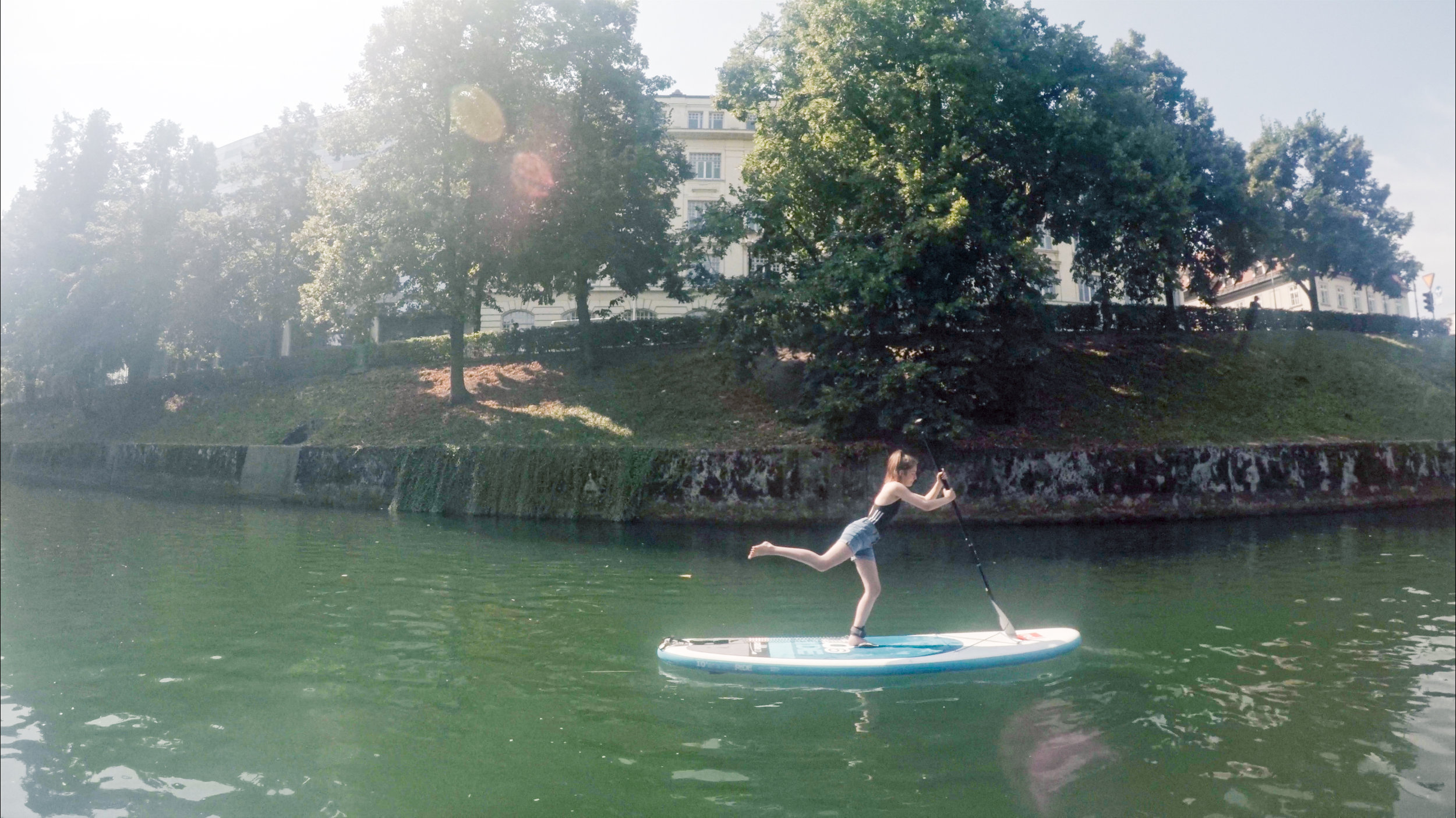 Paddle boarding yoga along the Ljubljana river