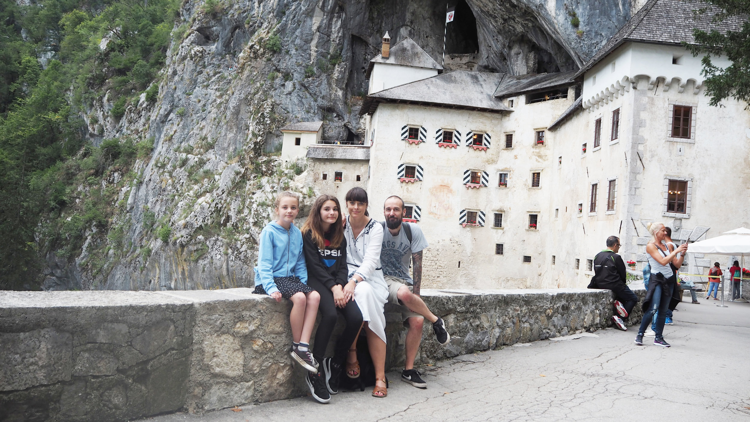 Predjama castle with the Little Flea family