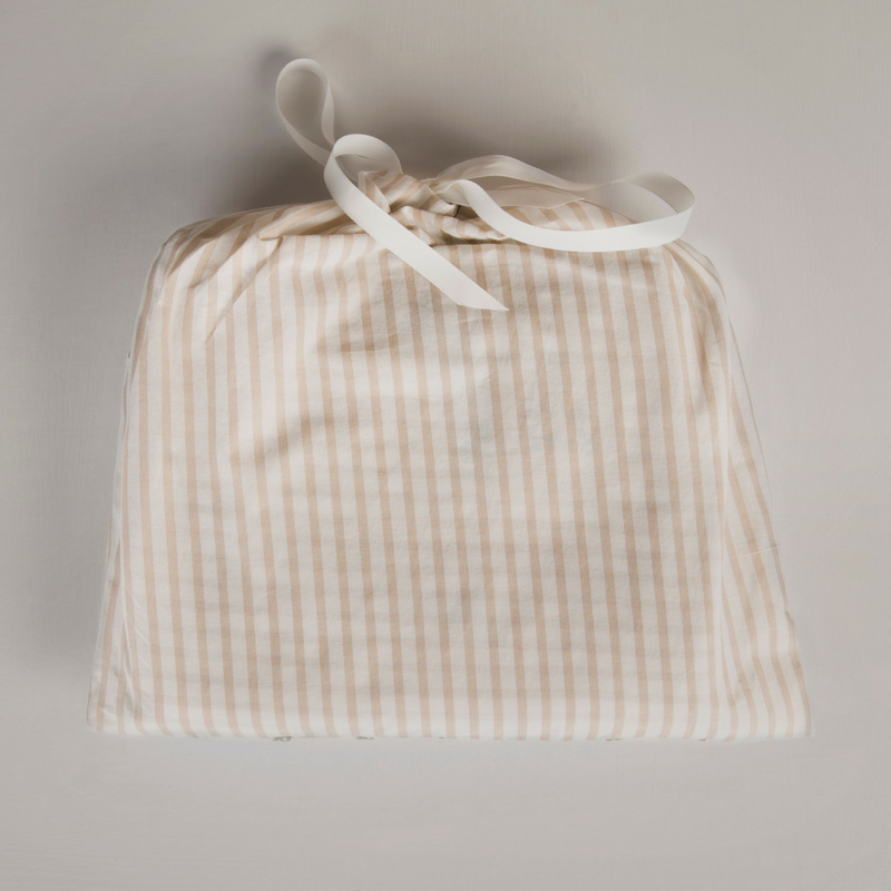 Hope and Fortune organic cotton blanket in a drawstring bag