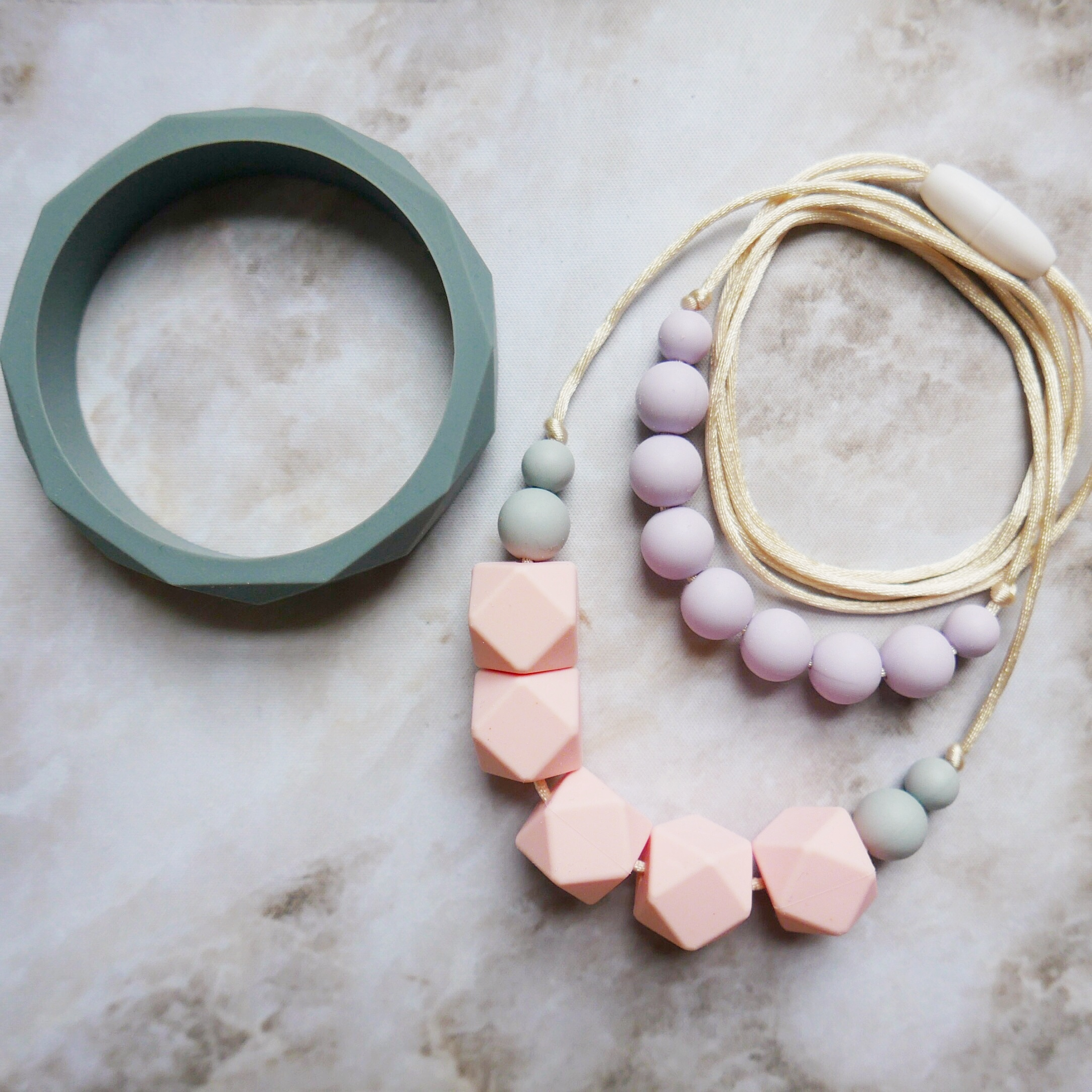 East London Baby Company teething jewellery neutral pink , lilac and grey