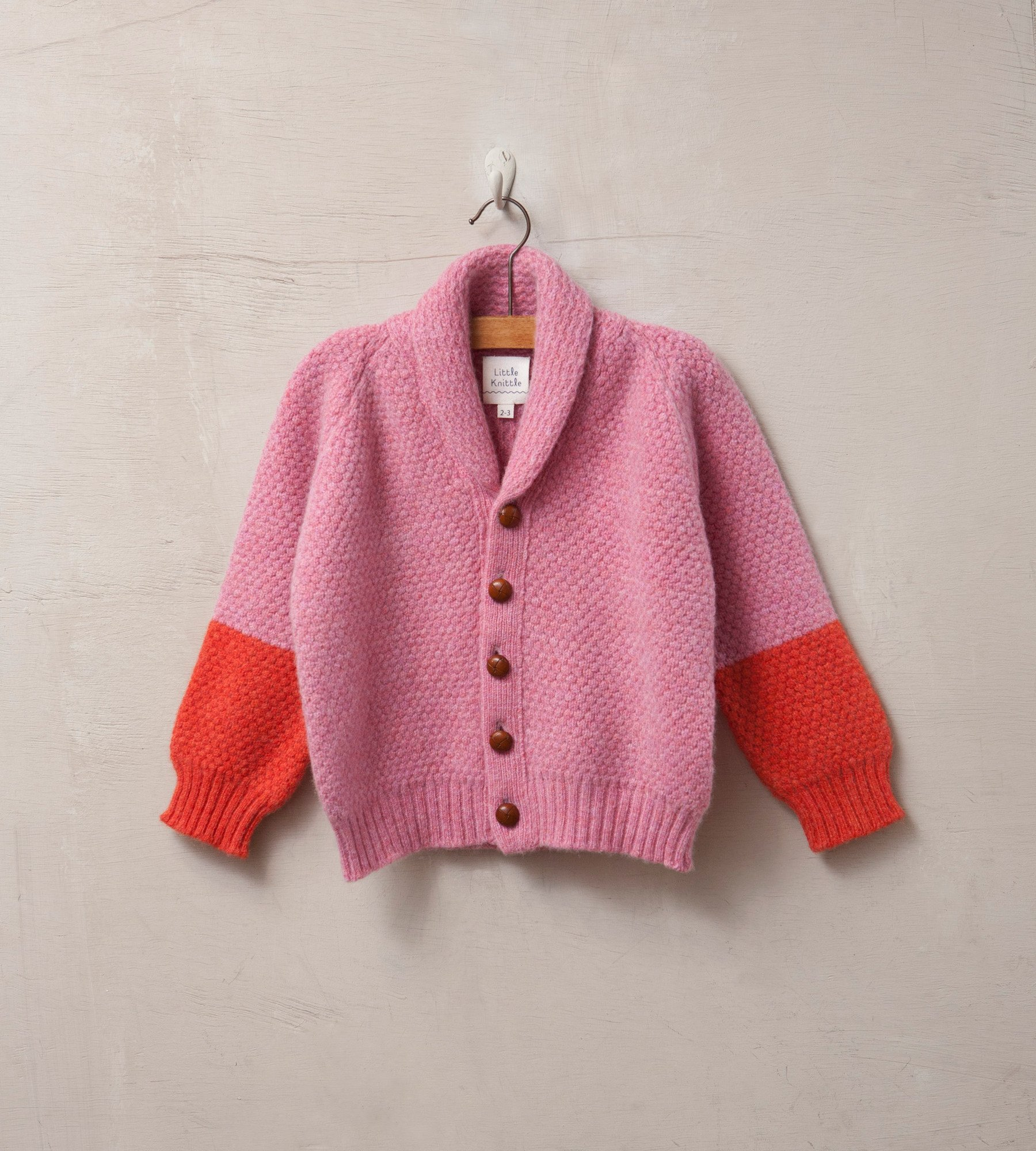 Pink & red cardigan, £65 Little Knittle