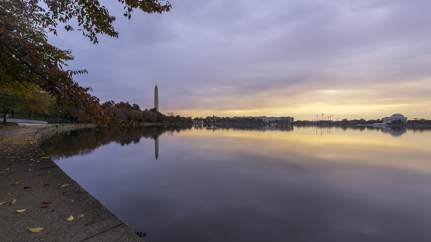 Tidal Basin in Fall colors. Cherry trees with Washington Monument and Jefferson Memorial, Washington D.C.