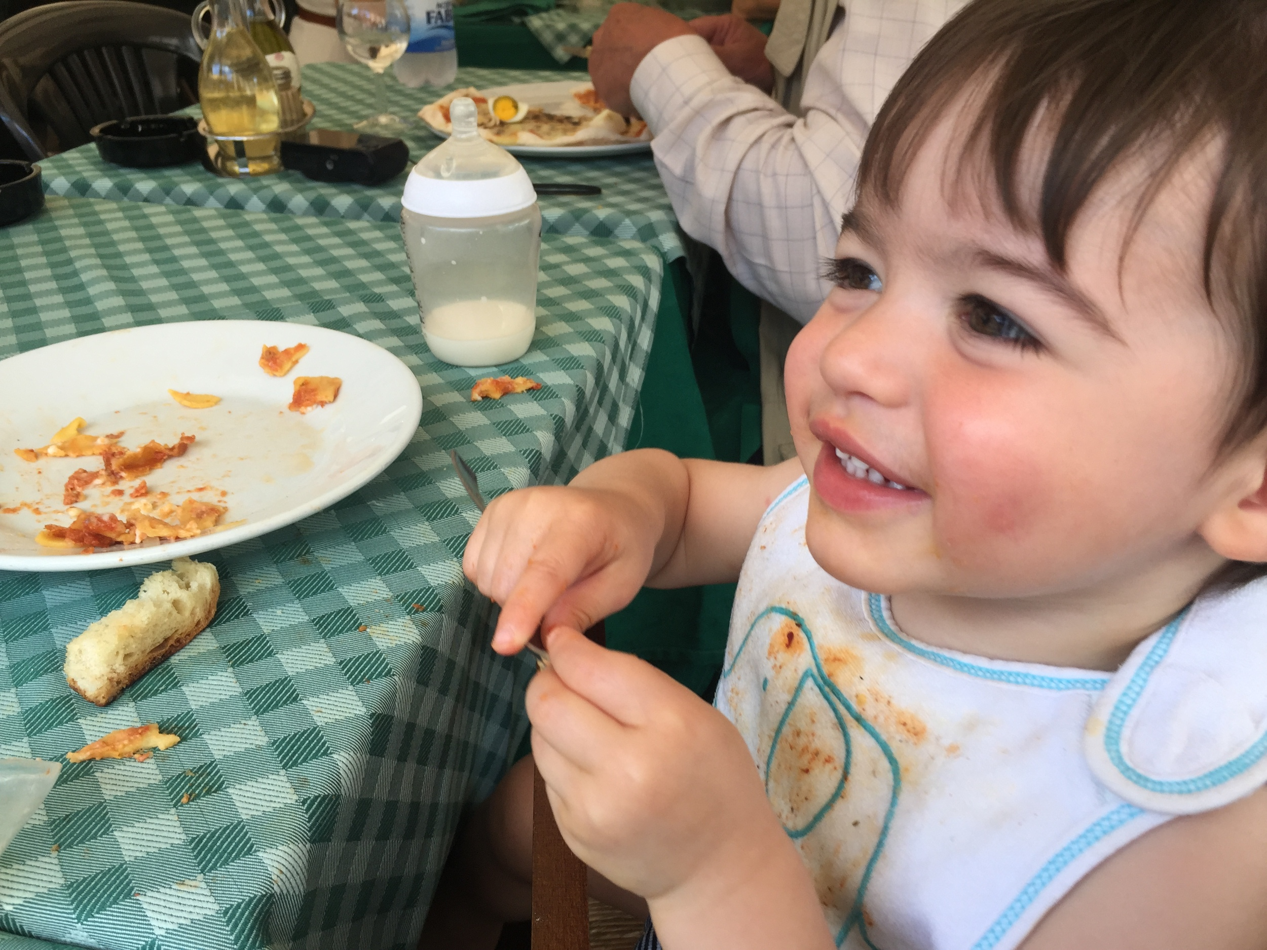 My baby boy, chowing down on pizza at Carlo Menta in the Trastevere area of Rome, Italy.