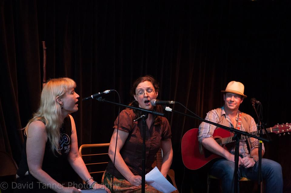 Lynette and Kari Tauring singing some verses from The Kalevala, June 19, 2014, at the Hootenany, Harriet Brewing, Minneapolis, with George Scott McKelvey looking on. Photo by David Tanner.