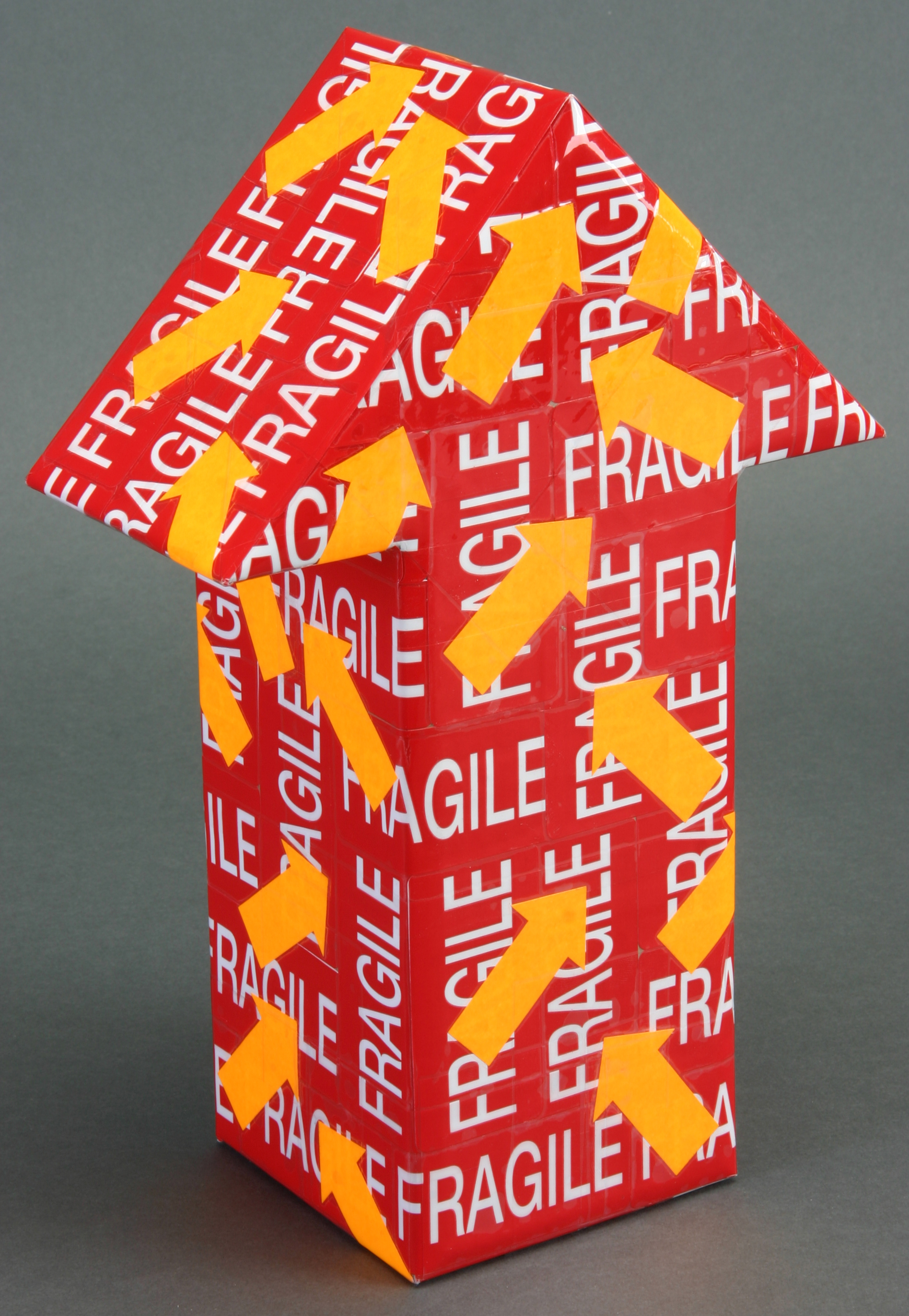 Mini - Reg Fragile Orange arrow.JPG