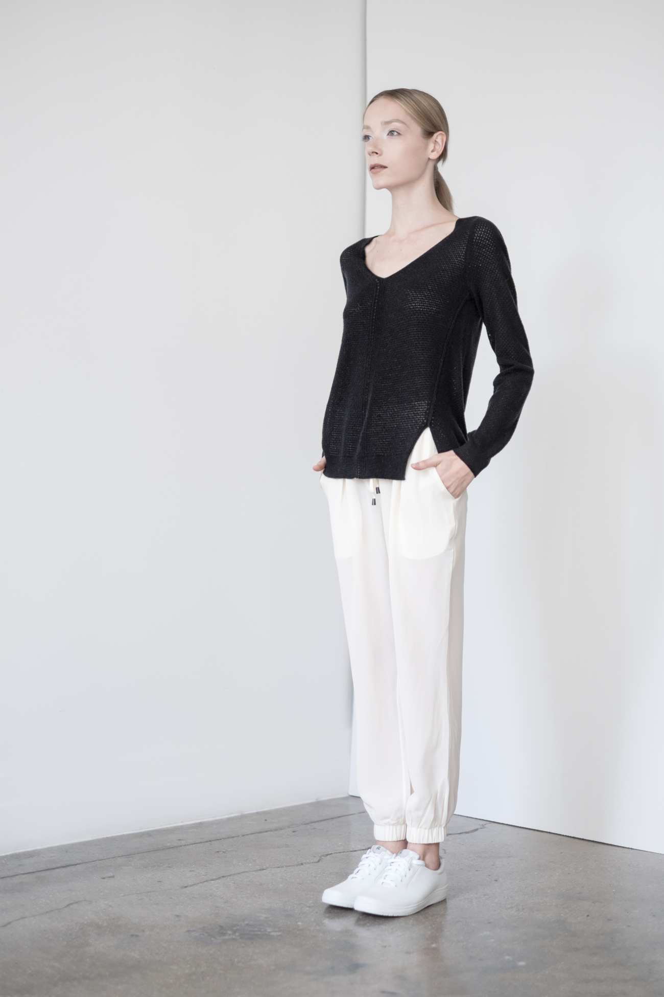 LOOK 39   TOP:   2276  / Noir   -     Audrey open mix lace stitch pullover, in fine gauge cashmere. WS:  132   BOTTOM:   2203  / Bone -    Jogger pants in 100% Silk. WS:  123
