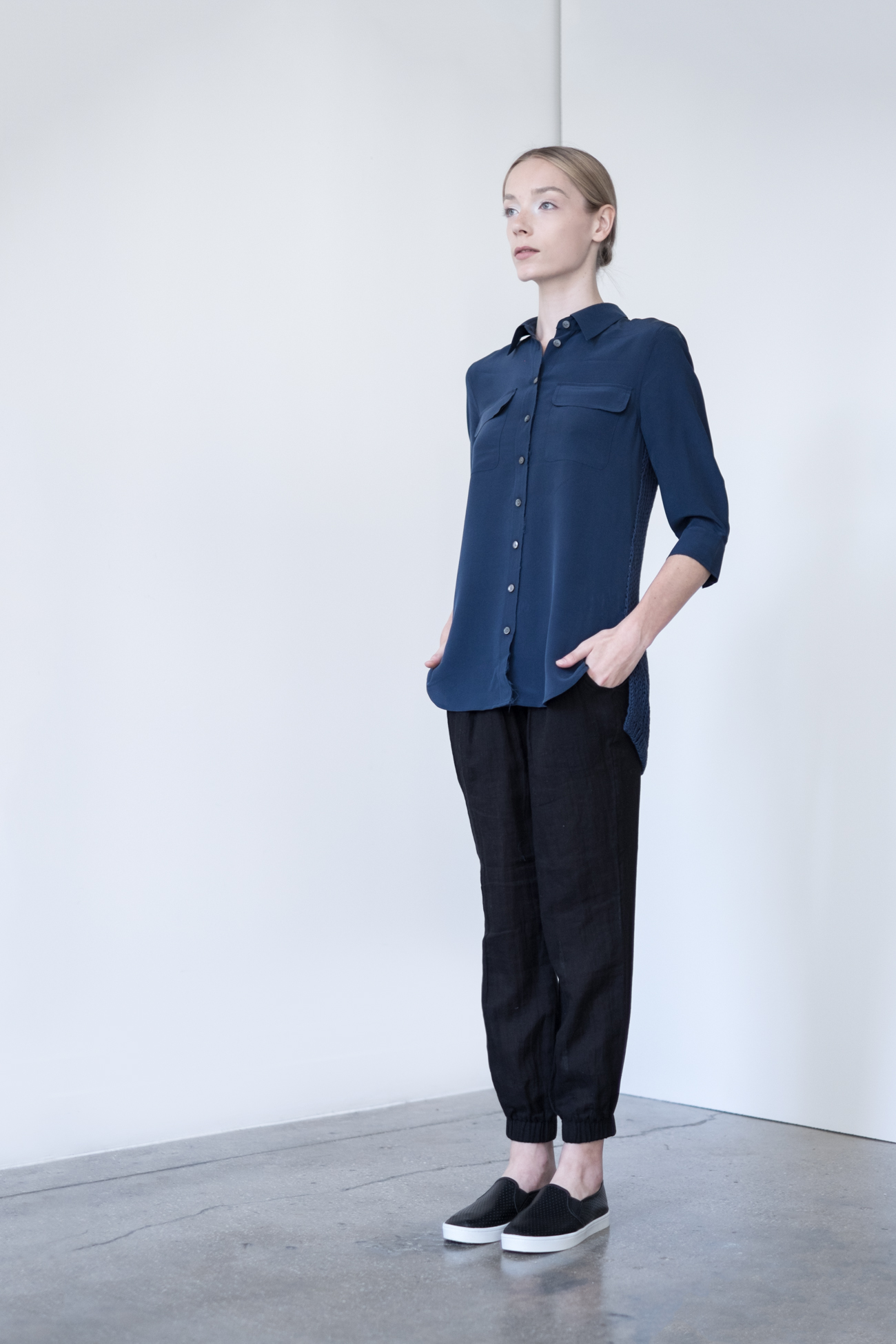 LOOK 46   TOP:   2268  / Navy   -     Jane 3/4 Sleeve silk blouse with sweater back insert. WS:  125   BOTTOM:   2290  / Noir  -   Jogger pants in 100% Cotton woven dbl. layer gauze.