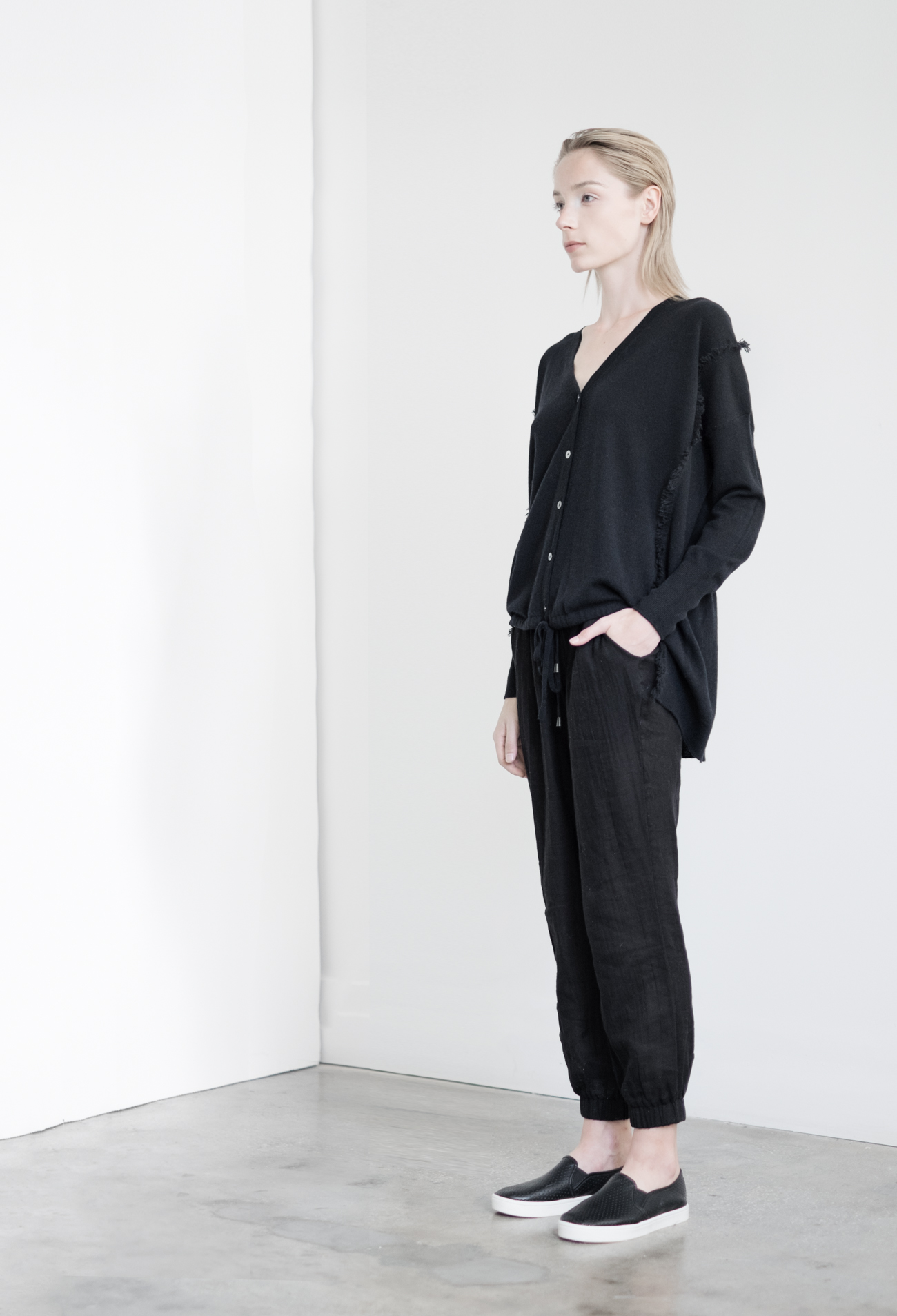 LOOK 48   TOP:   2201  / Noir  -     Vee cardigan with ruched front and waist in fine gauge cashmere. WS:  177   BOTTOM:   2290  / Noir  -   Jogger pants in 100% Cotton woven dbl. layer gauze. WS:  88
