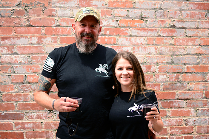 Brittney Hogan (Founder of Virago Fitness/Co-Founder of Circle HD Rodeo) with Father-In-Law,Steve Hogan (Co-Founder of Circle HD Rodeo) enjoying some vino at the Ft. Worth Stock Yards.