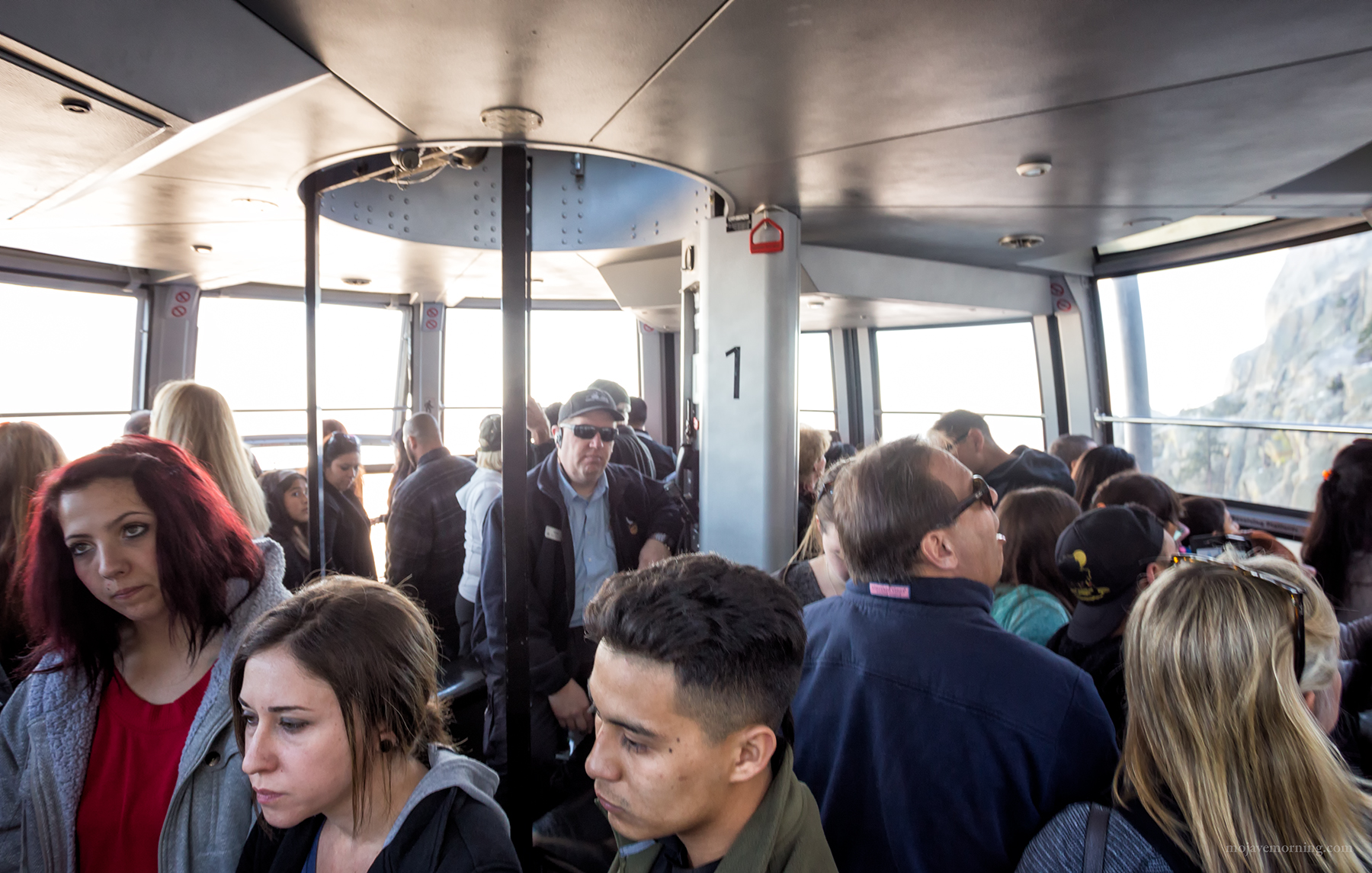 Inside the tram everyone is rapt as the view grows increasingly spectacular... and the drop increasingly far. Everyone, that is, except the operator. The cars hold up to 80 people and are also the only means of getting water and supplies up to the park at the top.