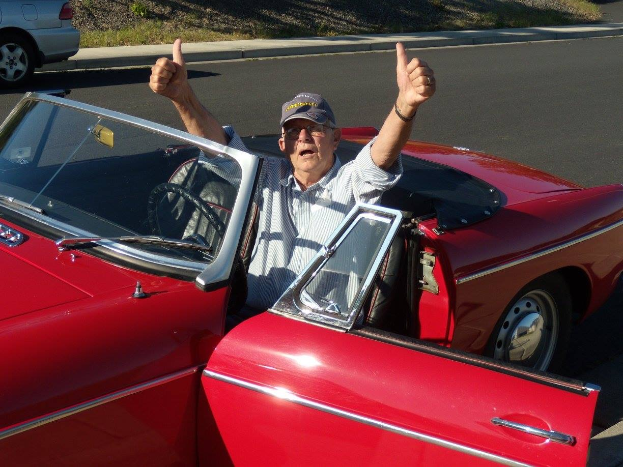 My dad in his beloved MG (and ragged Oregon ducks hat that didn't leave his head for oh, about ten years) that he restored.