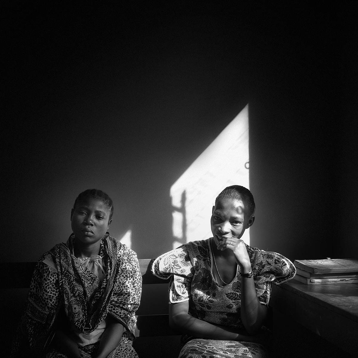 """Sisters waiting in Tanzania. / From the series """"Waiting"""""""
