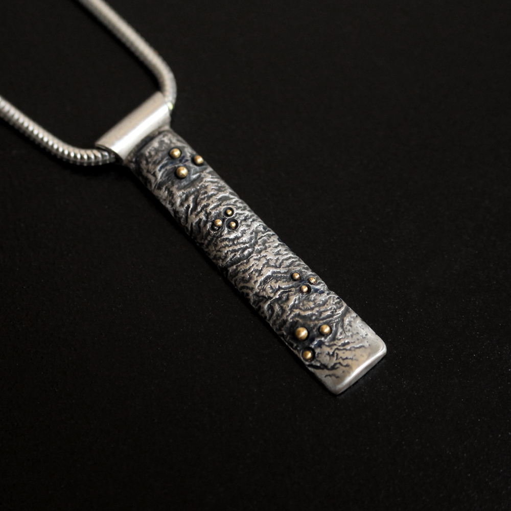 Textured Pendant With Gold Grains