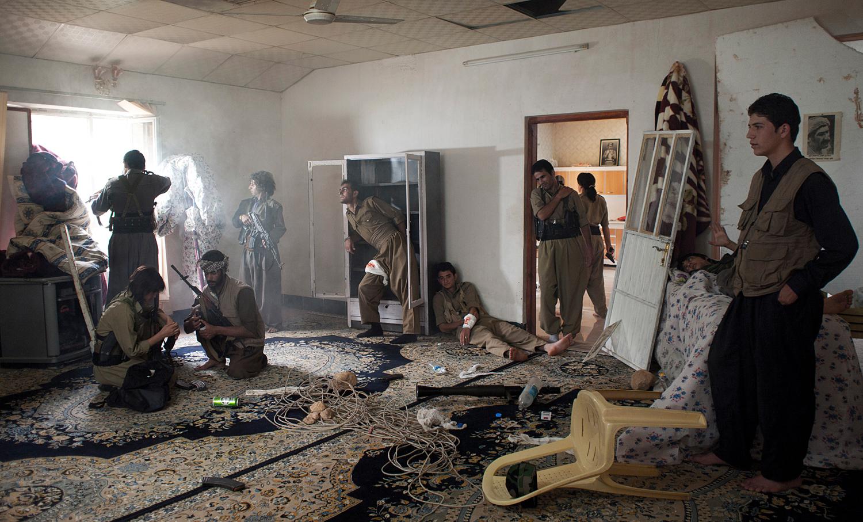 Emeric Lhuisset. Theater of war. photographs with a group of Iranien Kurdish guerrilla. Lambda Durst. 120 x 72 cm. Iraq. 2011.jpg