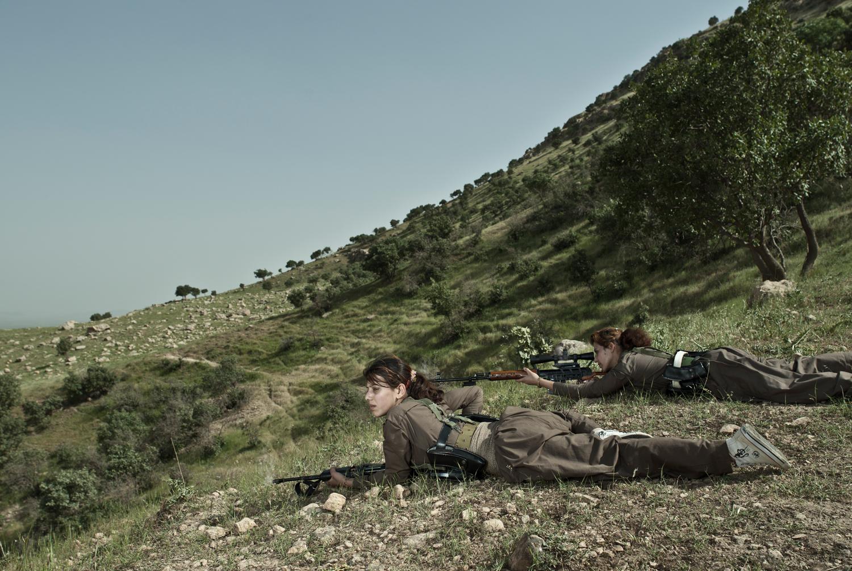 Emeric Lhuisset. Theater of war. photographs with a group of Iranien Kurdish guerrilla. Lambda Durst. 150 x 100cm. Iraq. 2012.jpg