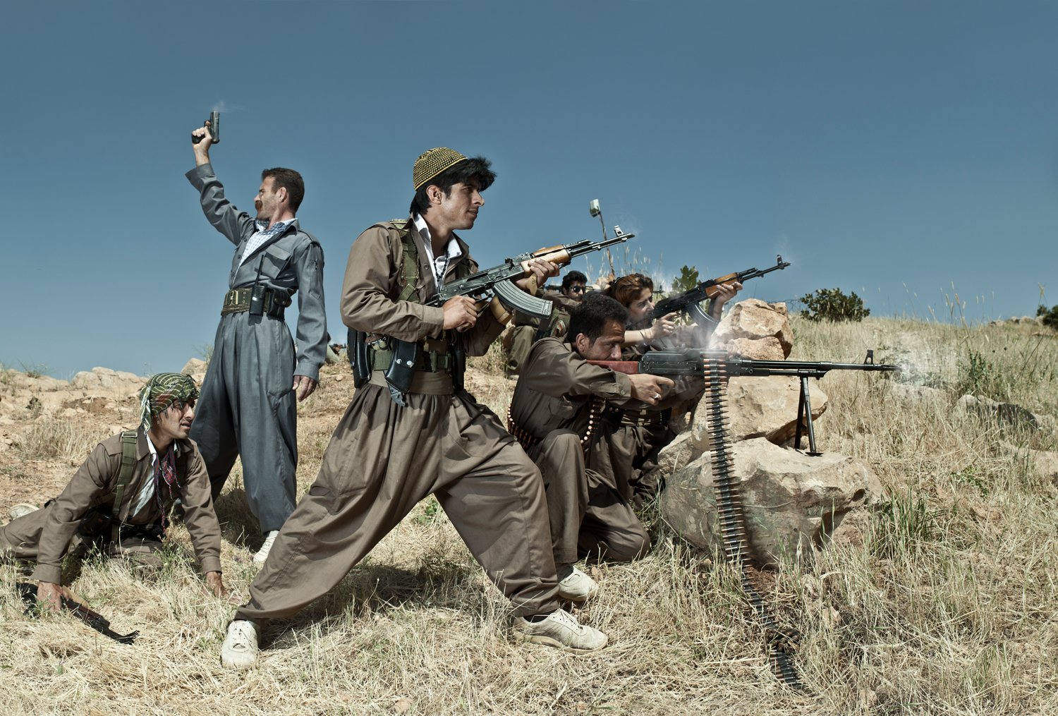Emeric Lhuisset. Theater of war. photographs with a group of Iranien Kurdish guerrilla. Lambda Durst. 120 x 177cm. Iraq. 2012.jpg