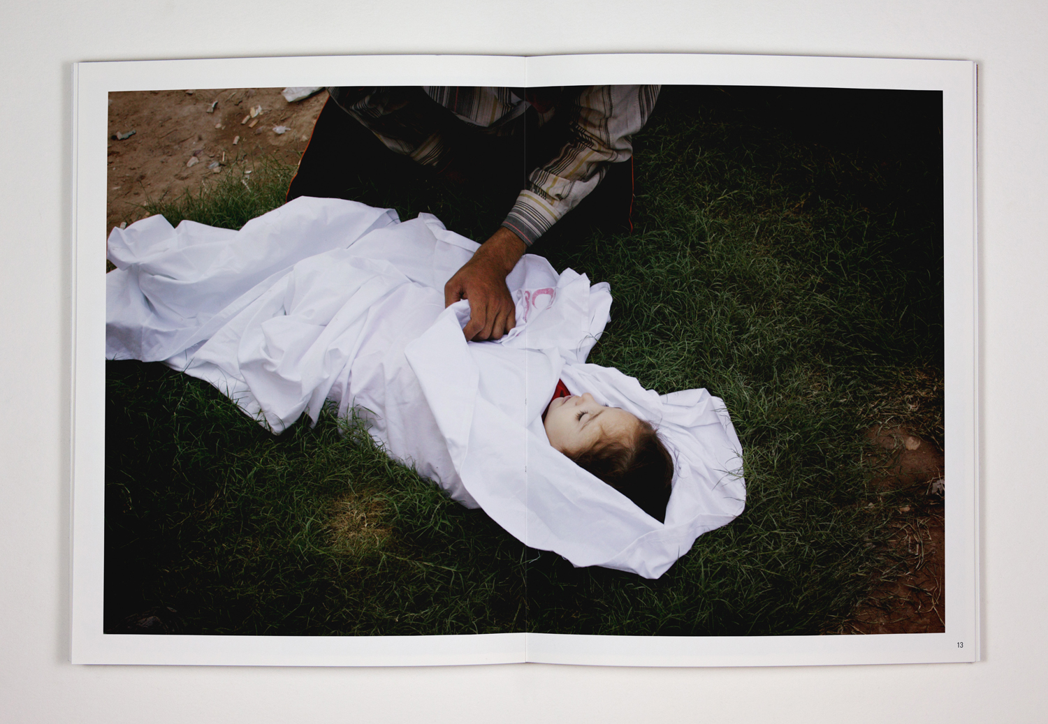 31. A young girl named Sahra was among the victims of the Kadhimiya stampede. An uncle stayed with the dead child while her father went searching for his wife – her mother – who was still missing. 31. Aug 2005. Baghdad, Iraq