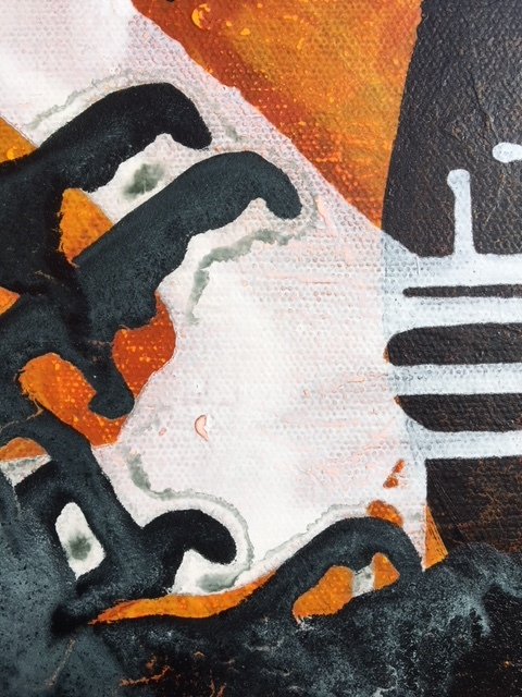 Detail of poured paint (dry) on one of the 24 inch square canvases.