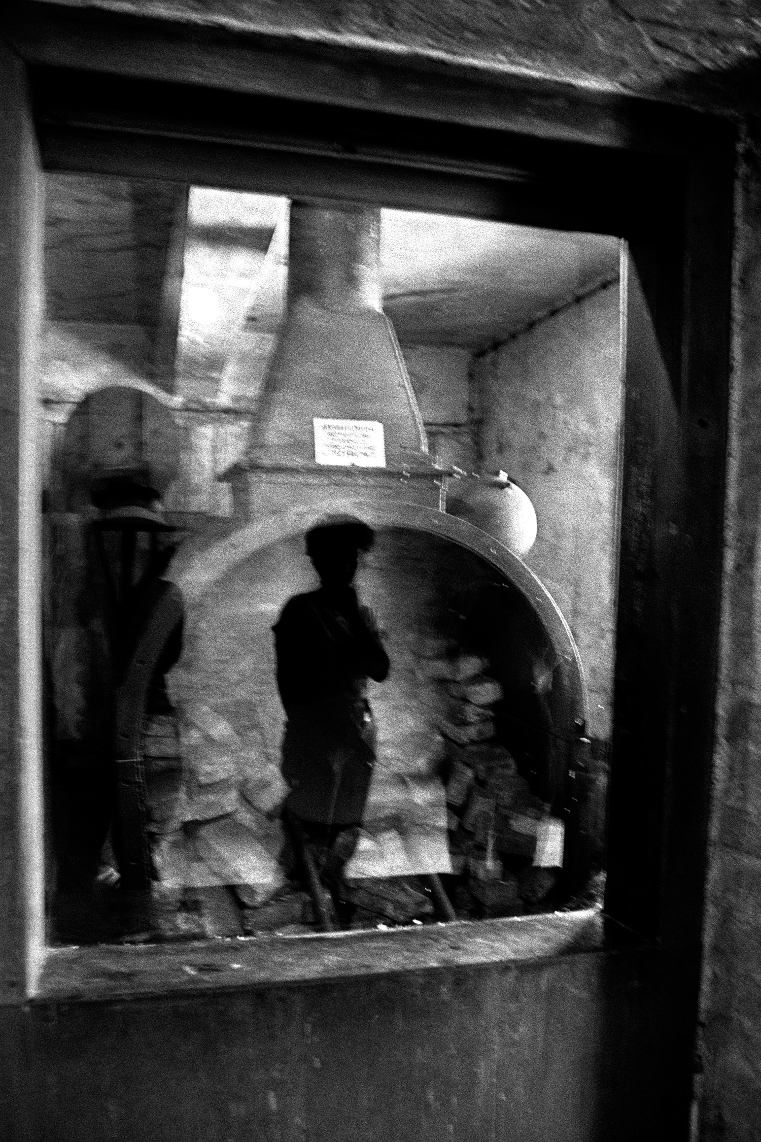 Reflection of Woman Viewing Oven
