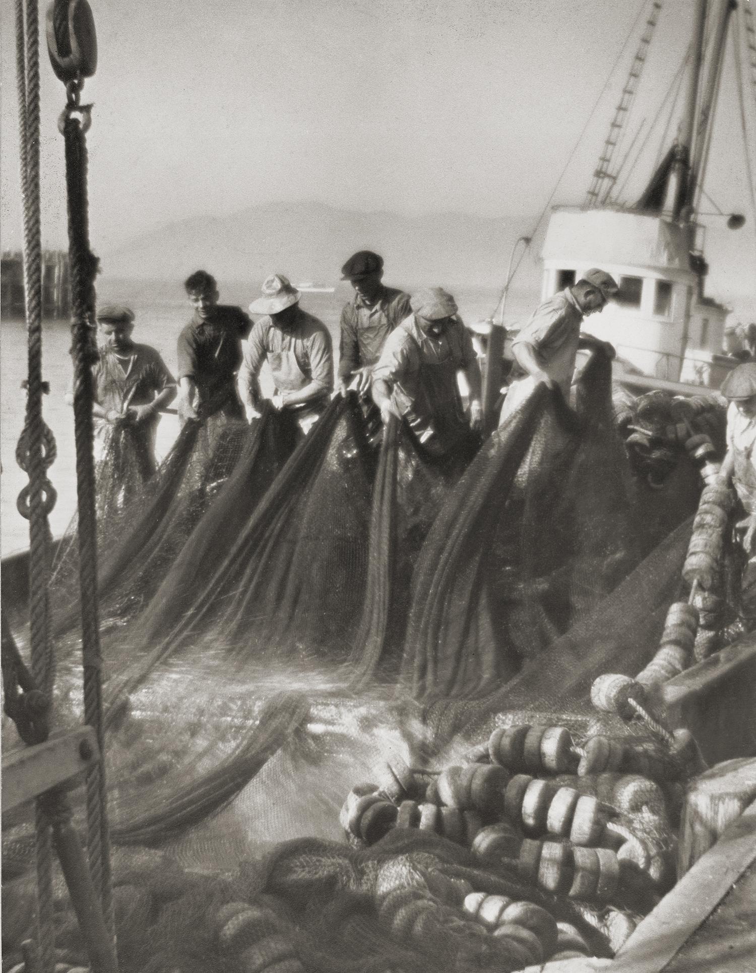 Washing their nets at Fisherman's Wharf