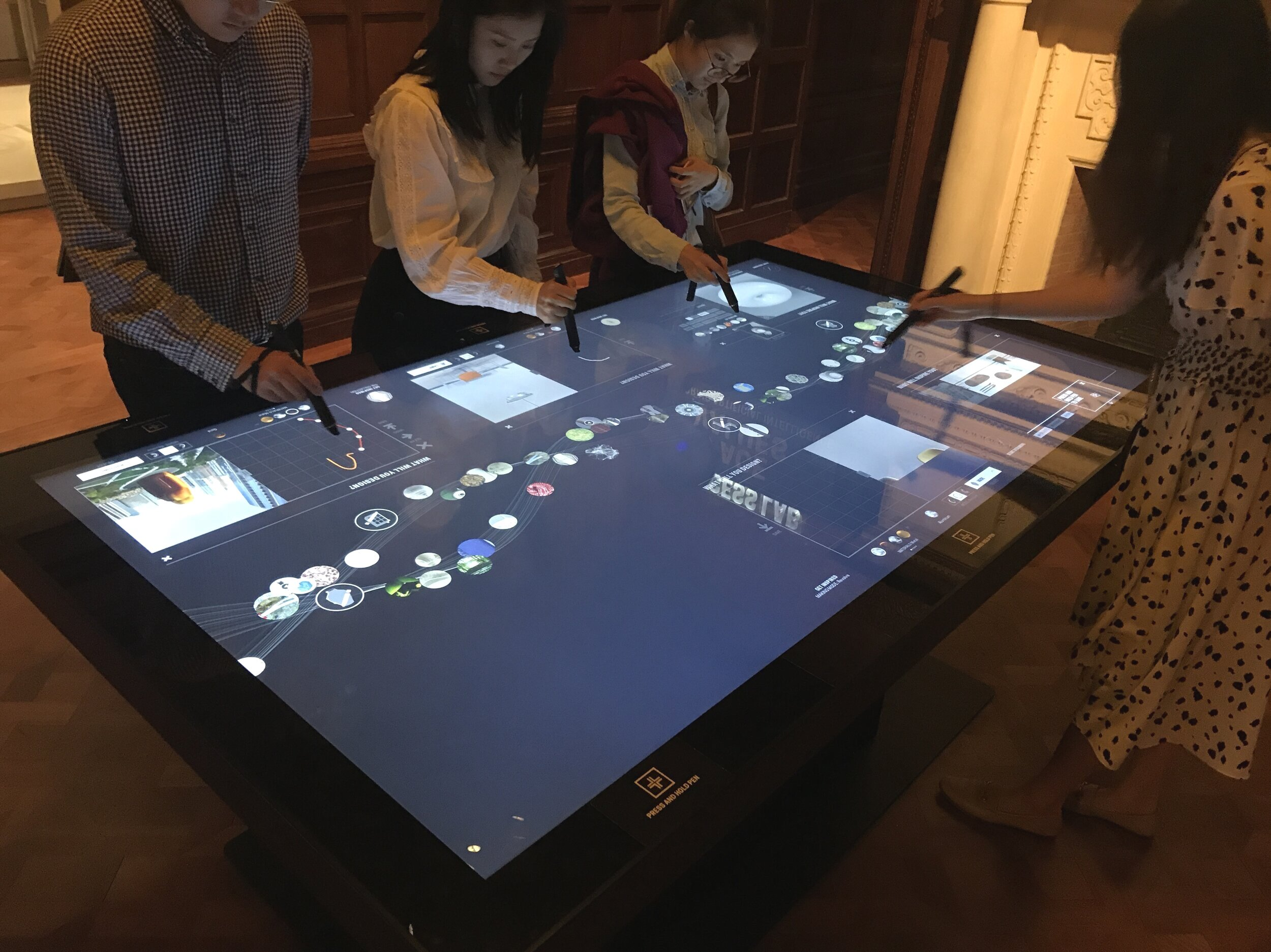 the interactive table act as a informative station for overall exhibition, also as a part of the mapping design for the pen as an information collecting device
