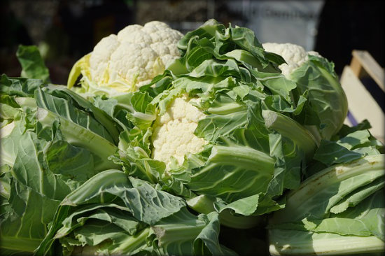 Crisp, green leaves are a sign of a good cauliflower. The leaves offer protection for the cauliflower
