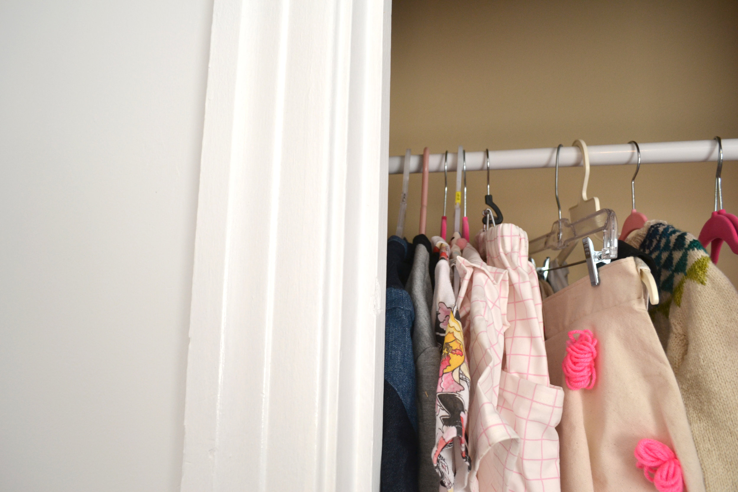 Another thing I absolutely love about my space in the house is the closet storage space I have in this room. I can put away all the ugly fabric storage and stuff that doesn't need to be out all the time and have a nice clean workspace when I need it. I can also hang up all of the samples I sell at craft shows which keeps them nice and tidy.