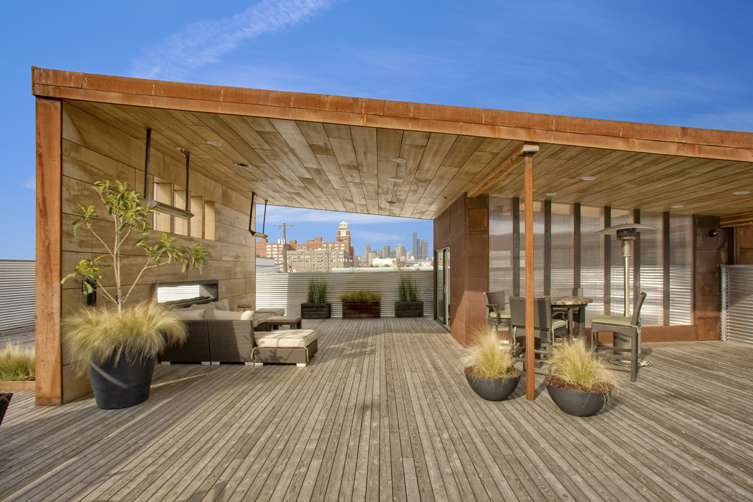 3000 sq. ft. rooftop deck—1000 sq. ft. covered with built-in heaters—fireplace, seating, satellite bar with video, audio, and views of downtown Seattle