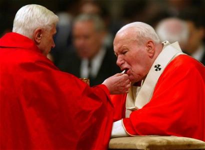 ratzinger giving communion to jpii.jpg