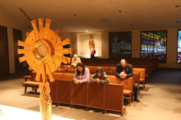 people praying at adoration.jpg