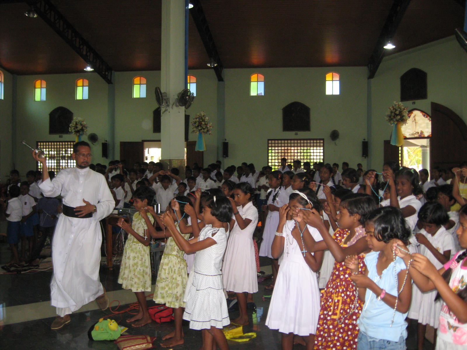 children in church with rosary.jpg