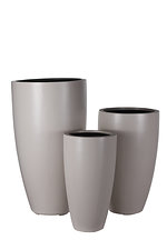 example of a tall crucible grc planter in a light grey painted finish