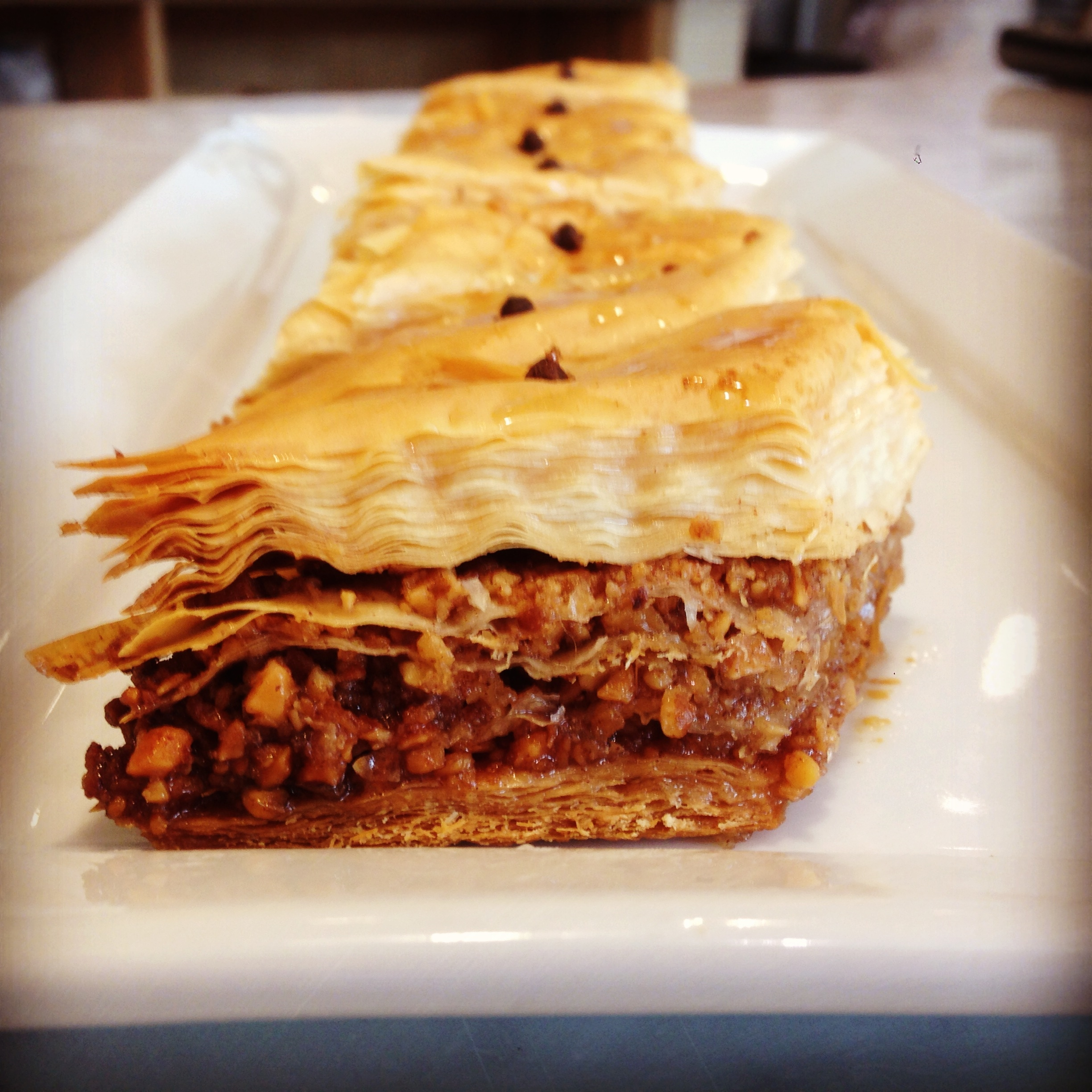 Baklava -  Showcasing crispy filo, toasted walnuts and almonds, cinnamon , orange blossom honey and a hint of brandy.  Don't be intimidated, once you learn to work with filo, it will only take you about an hour and will be a show stopper for your holiday table